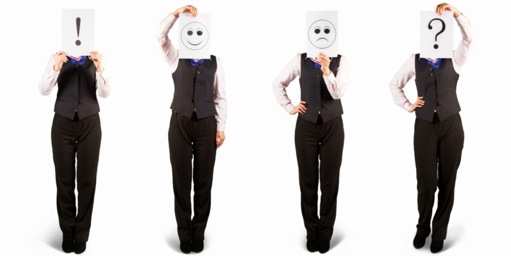 Two workers, one demonstrating employee emotions, including employee happiness