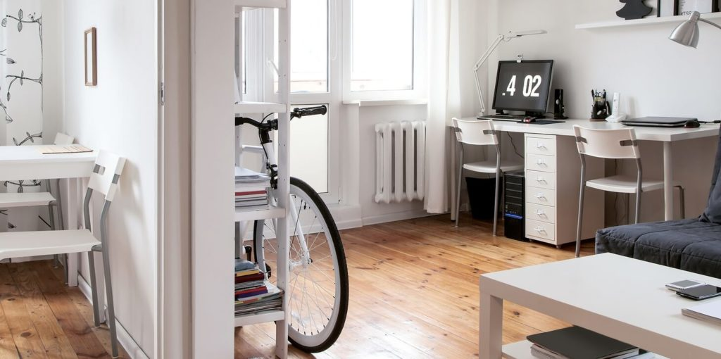 Bike in an apartment representing alternative commutes.