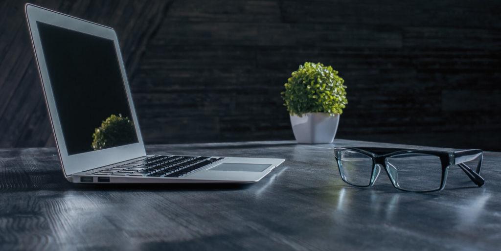 Desk of an employer looking at digital portfolios