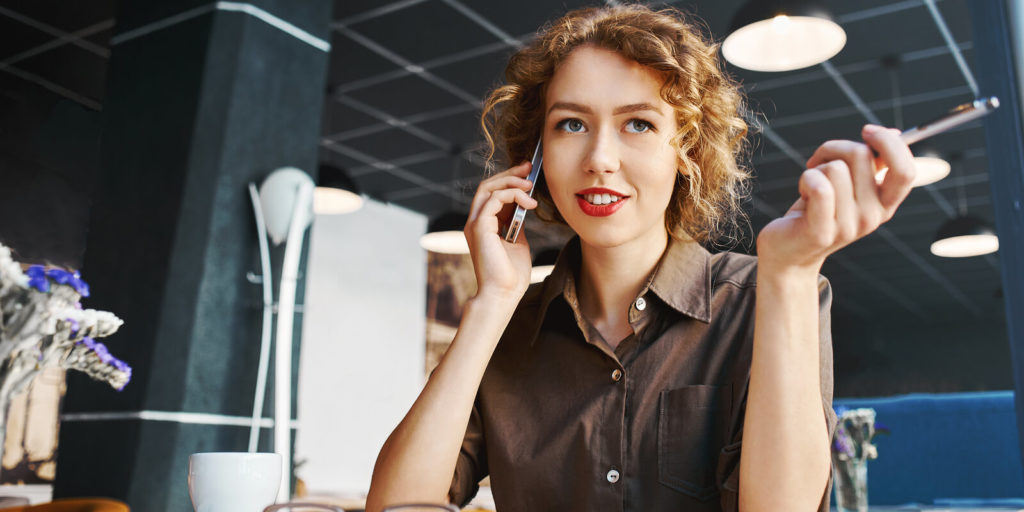 Woman employer on a phone interview talking about interview questions you should ask.