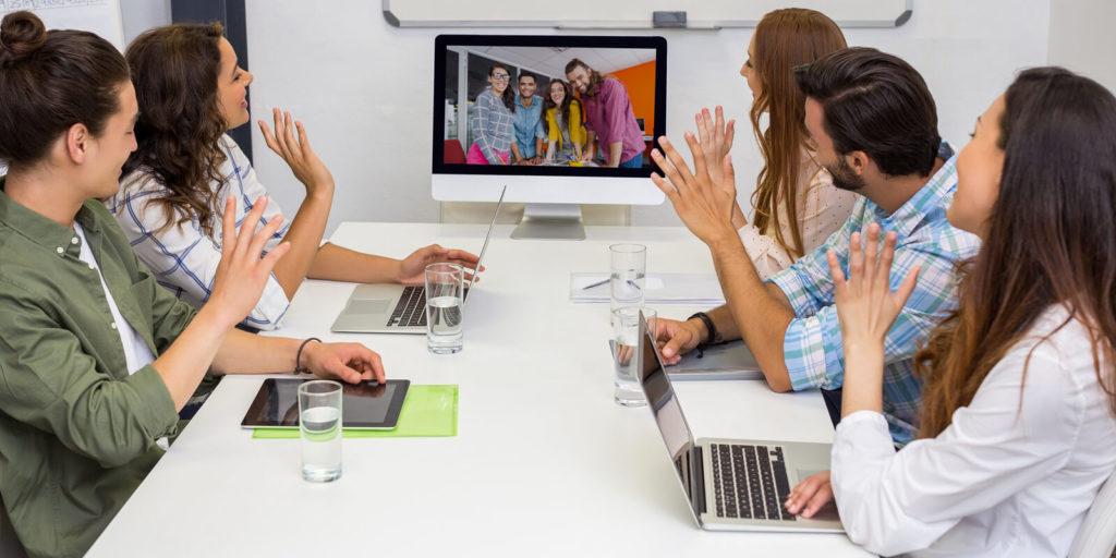Employer learning how to run a meeting with remote and on-site employees.