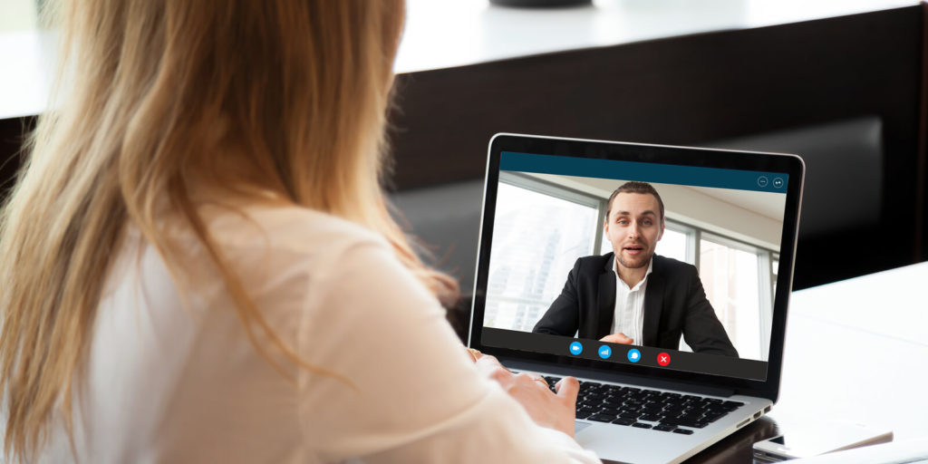 Woman trying not to make virtual interview mistakes.